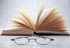 Reading habit. Book and a pair of spectacle stock image