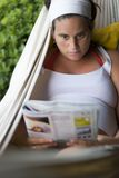 Reading on a hammock Stock Photos