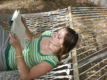 Reading in the Hammock Stock Photo