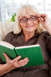 Reading her favorite book. Stock Photos