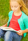 Reading her favorite book. Royalty Free Stock Photo
