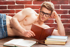 Reading his favorite book. Stock Photo