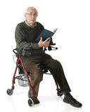 Reading on His Walker Stock Image
