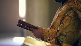 Reading the Holy Gospel. Hands Orthodox priest turns the page stock video footage
