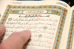 Reading The holy Quran Stock Images