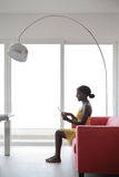 Reading at home. Black beautiful woman reading at home Royalty Free Stock Photos