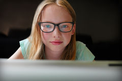 Reading homework online Royalty Free Stock Images