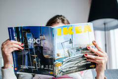 Reading IKEA Catalogue stock photo