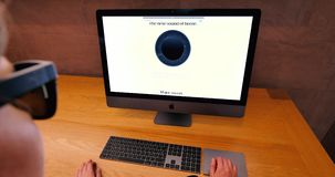 Reading on iMac About HomePod speaker. STRASBOURG, FRANCE - CIRCA 2018: woman pov working in Apple Store using the workstation New iMac Pro the all-in-one stock footage