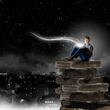 Reading and imagination Royalty Free Stock Image