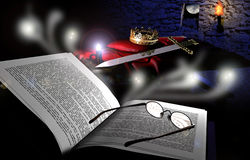 Reading and imagining. A book with glasses above. Our imagination steals towards the contents of the book, the room of a king with its sword, its crown, and in Royalty Free Stock Images