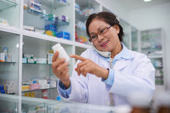 Reading indications. Pharmacist reading indications to the customer on the phone royalty free stock photography