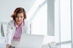 Reading information on laptop Stock Photo
