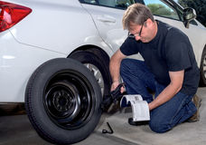 Reading instruction on replacing a spare tire Stock Images