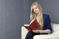 Reading an interesting book Royalty Free Stock Image
