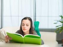 Reading interesting book Stock Photos