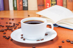 Reading interesting books over a cup of coffee Royalty Free Stock Images