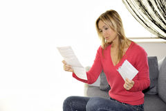 Reading invoice on her flat Royalty Free Stock Images