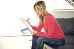 Reading invoice on her flat Royalty Free Stock Photos