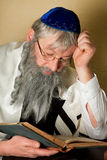 Reading a jewish book. Old jewish man with beard reading a book Royalty Free Stock Photos