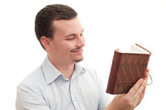 Reading a journal. Caucasian male happily reading a leather bound book/journal Stock Images