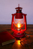 Reading at kerosene lamp light Stock Photo