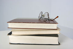 Reading is knowledge. Books with a pair of eyeglasses Royalty Free Stock Photos