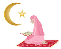 Reading the koran Stock Images