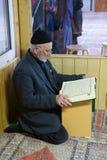Reading the koran Stock Photo