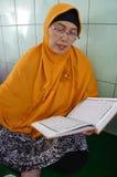 Reading the koran Stock Images