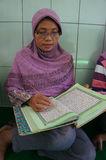 Reading the koran Stock Photography