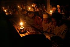 Reading koran using torch Royalty Free Stock Images