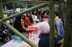 Reading koran using torch Stock Photos