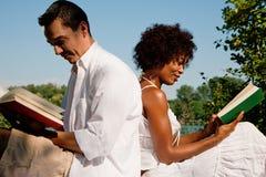 Reading at the lake Royalty Free Stock Image