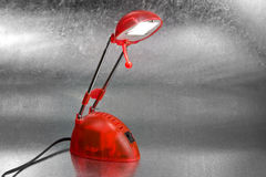 Reading lamp. Red reading lamp on silver background Stock Photos