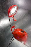 Reading lamp. Red reading lamp on silver background Royalty Free Stock Image