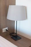 Reading lamp on bedside table Royalty Free Stock Photo