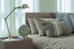 Reading lamp and clock next to japanese style bedding Royalty Free Stock Photo