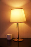 Reading lamp and cup Stock Image