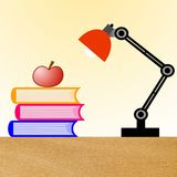 Reading-lamp, three books and apple on a table Royalty Free Stock Images