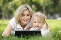 Reading Laptop Outside Royalty Free Stock Images