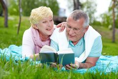 Reading on the lawn Stock Image
