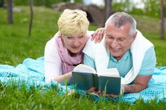 Reading on the lawn Royalty Free Stock Photo