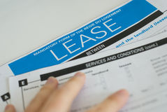 Reading a lease. Carefully before signing Royalty Free Stock Images