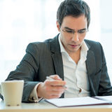 Reading legal documents Stock Image