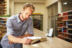 Reading in library Stock Photos