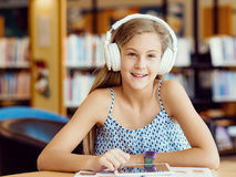 Reading and listening Stock Images