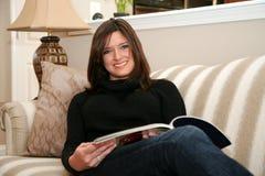 Reading A Magazine Royalty Free Stock Image