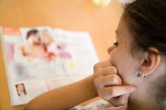 Reading the magazine stock photos