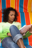 Reading a magazine Stock Photo